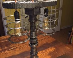Steampunk lamp made from malleable steel 1/2 BSP pipe fittings. 6 foot flex complete with on off switch. 400mm high x 300mm wide. Lamp holder takes screw fitting bulb, supplied with lamp