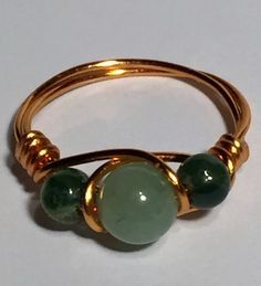 Handcrafted wire-wrapped Aventurine & Kiwi Jasper bead ring. Beads consist of one 6mm Aventurine and two 6mm Kiwi Jasper. Wire is anti-tarnish copper artistic wire. If you would like this same ring in