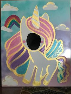 This shiny unicorn photo op is a must at your unicorn themed celebration! Party guests of all ages will love to pose in this photo-op. This has been painted by hand onto a 40x32 inch foam board. The wings, hair, clouds and rainbow are loaded with colorful sparkly glitter and the unicorn