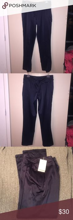 """NIKE GOLF Dri-Fit Pants NWT!! From Nike golf women's collection. Contemporary, athletic style graced with modern details. Sophisticated golf apparel for your active lifestyle. Navy blue pants with zippered side pockets and zippered back pocket. Laid flat waist measures 15"""", inseam is 30"""". Nike Pants"""
