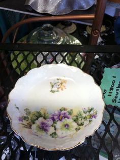 Hey, I found this really awesome Etsy listing at http://www.etsy.com/listing/157781121/vintage-violet-small-dish-w-gold-trim