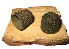 Medieval beehive thimbles from 14thC -- Thimbles dating to the 10th century have been found in England, and they were in widespread use there by the 14th century. The vast majority of metal thimbles were made of brass. Medieval thimbles were either cast brass or made from hammered sheet. Early centers of thimble production were starting with Nuremberg in the 15th century, and moving to Holland by the 17th. -- See more at: http://www.ukdfd.co.uk/pages/thimble.html