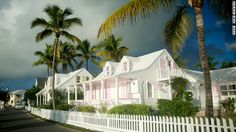"Pretty islands | Eighteenth-century cottages dot the seafront of Dunmore Town on Harbour Island, visited weekly by the ""MV Bahamas Daybreak III."""