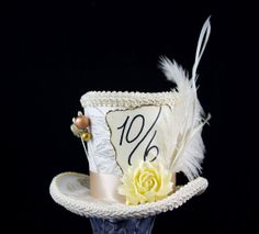 Ivory and Cream Mad Hatter Mini Top Hat Fascinator, Alice in Wonderland, Tea Party, Derby Hat, Victorian, Feather and Resin Flower on Etsy, $42.00