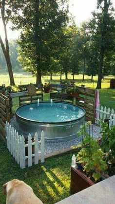 "Wow! found on Pinterest but no details-looks pretty cool though! looks like they edged the galvanized tub/stock tank with either pipe insulation or pool noodles...love the pallet fencing! I'll bet you could even make a ""cover"" from a plastic/vinyl tarp!"