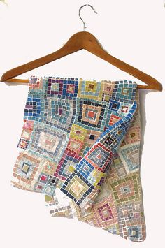 I like the idea of doing a mosaic-look quilt. I have a ton of tiny scraps that I could use, but it would take forever!