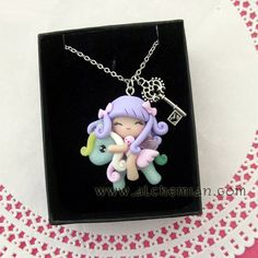 *POLYMER CLAY ~ 1 cute winged  fairy ooak necklace made in italy.