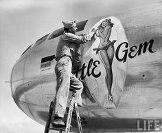 "B-29 ""Little Gem""  U.S. Marine Randall Sprenger putting the finishing touches on ""Little Gem"",a pin-up adorning a B-29 Superfortress.  Isley Field,Saipan,Marianas Islands; Feb. 1945."