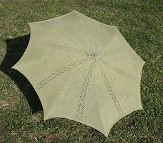 A knitted umbrella.  Hmmmmm, I like to knit, no, I LOVE to knit, but I am not sure I would go this far.  It is pretty, though.