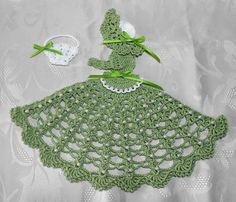 Green Crinoline Lady with Pearl embellishment. 8 inches tall.