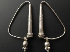 "Omani silver earrings or stunning form, used as part of a headdress. Posted by Jose M. Pery on ""ethnic jewels""."