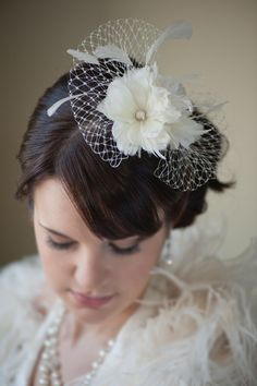 Bridal Fascinator, Birdcage Veil, Feather Fascinator -  I like this one because it doesn't cover the face. $85.00, via Etsy.