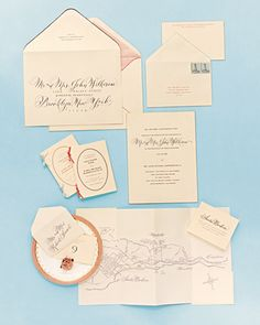 Both unusual and classically formal:  engraving on thick, creamy card stock and handwriting each guest's name (classic) while mixing traditional type and fonts with ornate calligraphy, and using offbeat ink color and paper combinations (unusual).
