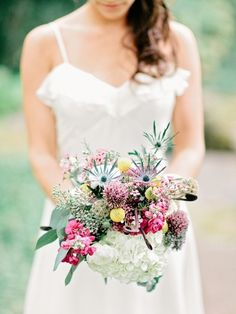 Hydrangeas, craspedia, and other textured florals make this an eclectically beautiful bouquet! | Photo by Amy Arrington