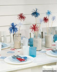 Don't know where to find those fireworks things but love the simplicity of sand in mason jars for the centerpiece.