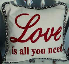 Hand painted Love is All You Need pillow by Full Circle Creations