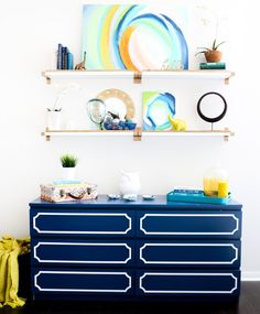 Modern gold a white shelf DIY project using spray paint and IKEA shelf pieces - Hack It - Gold and White Shelves