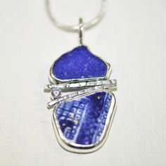 Artisan metalwork pendant crafted of cobalt blue sea glass and vintage sea pottery in a handmade original setting of sterling silver.