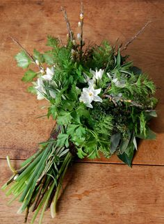 This winter market bouquet is a great reminder that cold weather herbs, like parsley, and bulb blooms can make a beautiful centerpiece.