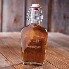 Men, say thank you to your groomsmen by gifting these custom engraved vintage flasks from The Man Registry.