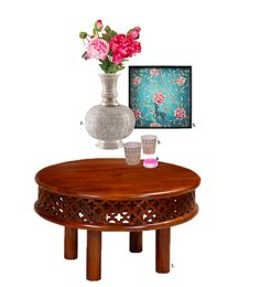 We love this colonial style coffee table decorated with a cast silver coated vase and silver votive, with complementing tea lights. The decorative turquoise tray is sure to steal the thunder in your living room. Mixmodern accents withantique items to make the space pop. Read our blog to shop these products!