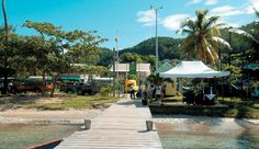 Tenders from cruise ships dock along this jetty at Port Elizabeth; just beyond the jetty's gate, safari-like touring vehicles await cruisers. Bequia, Port Elizabeth, Cruise Ships, Grenadines, Touring, Islands, Caribbean, Gate, Safari