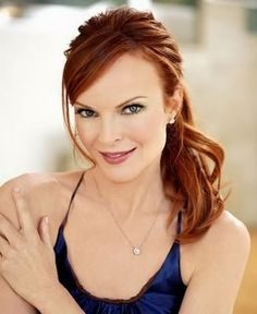Marcia Cross.  I love her hair, and I love the fact that she has not given in to tanning which is rampant in this country.  I appreciate that she loves her pale complexion.