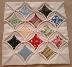 I always wanted to have a go with this quilting method - cathedral window.   So....I had a go!                 I usually do quilting to ...