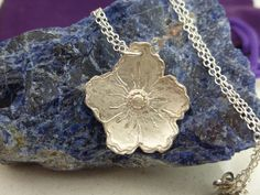 A personal favourite from my Etsy shop https://www.etsy.com/uk/listing/465088919/fine-silver-flower