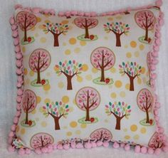 Children's colorful tree pillow in pinks and creams with pom-poms