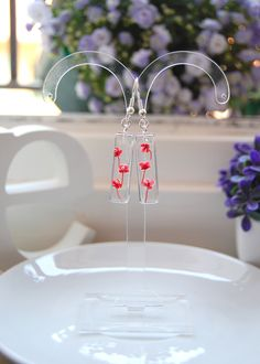 beautiful  resin earring with real small red flowers.  hand made!!!