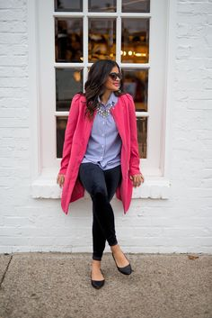 Spring outfit! Bright pink coat over striped button-up + statement necklace + velvet leggings + black flats.