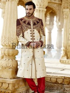 Royal look cream color jacquard #Sherwani ornamented with sparkling stone, beads work. Item Code : SSJ8353 http://www.bharatplaza.com/new-arrivals/sherwanis.html