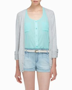Casual outfit, mint blouse, neutral cardigan, and shorts