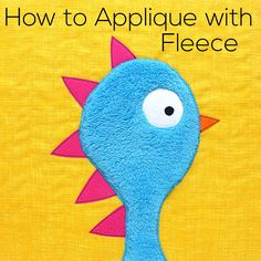 It's lots of fun to use cuddly soft fleece for your applique – and it's easy! But you can't use fusible adhesive for it. The heat needed to melt the adhesive will also melt your fleece. Not good! The solution is glue stick! You've seen me use glue stick before to hold pieces in place …