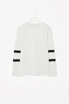 STRIPE SLEEVE TOP  A clean, modern style, this structured jersey top has a grosgrain ribbon stripe on each sleeve. Made from thick cotton-mix jersey with a lightly textured quality, it is a regular straight fit with a simple round neckline and neatly finished edges.