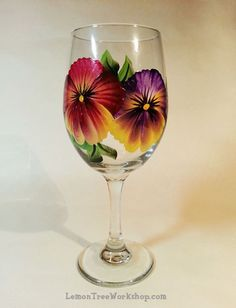 Pansies Hand Painted Wine Glass by LemonTreeWorkshop on Etsy: Diy Wine Glasses, Decorated Wine Glasses, Hand Painted Wine Glasses, Painted Wine Bottles, Pebeo Porcelaine 150, Glass Painting Designs, Wine Glass Crafts, Wine Bottle Art, Bottle Painting