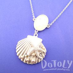 - Description - Details Accessorize like a mermaid would with this beautiful necklace featuring a seashell pendant covered in starfishes, pearls and rhinestones in silver! Store FAQ   Shipping Info  