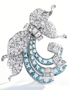PLATINUM DIAMOND AND AQUAMARINE BROOCH PAUL FLATO. Of foliate design decorated with ribbon scrolls set with round and single-cut diamonds weighing approximately 11.75 carats accented by square-cut diamonds weighing approximately 9.70 carats further set with 28 calibré-cut aquamarinessigned Flato circa 1940.