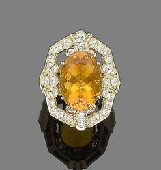 A fire opal and diamond dress ring  The raised oval mixed-cut fire opal, within an openwork surround set with brilliant-cut diamonds, diamonds approx. 1.15cts total