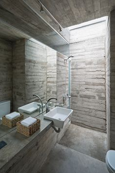Board-formed concrete also features in the bathroom of L4 House by Luciano Kruk…