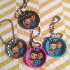 """Caleb and Sophia keychains. I copied the picture from jw.org. Then used a 1"""" paper punch to cut the pictures out. I purchase the bottle caps at Joann Fabrics. I used a foam paint brush and covered the inside of the bottle cap with mod podge. Then placed the picture on top and covered the picture with more mod podge. (Try to smooth the bubbles out) The keychains I also bought at Joann Fabrics from the Scrapbooking dept. It came in a set of 18 and I had to cut the chain apart."""