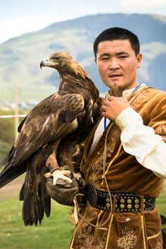 A man with his Eagle after competing at the World Nomad Games, Kyrgyzstan. Photo - NOMADasaurus  #centralasia #offthebeatenpath #Kyrgyzstan #eagle