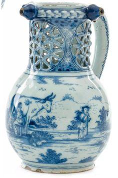 """Dutch Delft fopkan/pichet trompeur/puzzle jug with pastoral scene made by Geertruy Verstelle at factory """"Het Oude Moriaanshooft"""" between 1764-1768. Marked: G:V:S Height: 21 cm. Jeroen PM Hartgers"""