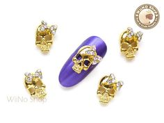 Style: Skull Measures : 12mm * 8mm Color : Clear Crystals Metal Base : Gold Tone Quantity : 2 pcs