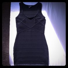 Forever 21 black bodycon mini dress F21 black bodycon dress, very stretchy! worn once says S/P but would fit medium even a large maybe small tear on right side of strap shown in picture got snagged on my dresser); but can be easily fixed. Buy for $20 plus shipping on Merc@ri use my code ACTHFZ and get $2.00 off Forever 21 Dresses Mini