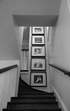 my B & W  stair case with B & W runner & brass stair rods (instead of carpet shown) and same grey paint and angle ceiling with black railing, white trim & Bannister