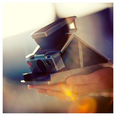 Photographic proof that the folding SX-70 Polaroid camera was brought to us directly from heaven.