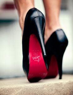 Classic black Louboutin pumps. Classy as hell.