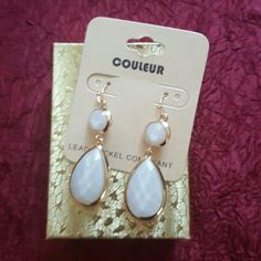 Tear Drop Shape White and Gold Color Earrings Metal color is gold and acrylic is color white.  Lenght of earrings is 2 inches. Jewelry Earrings